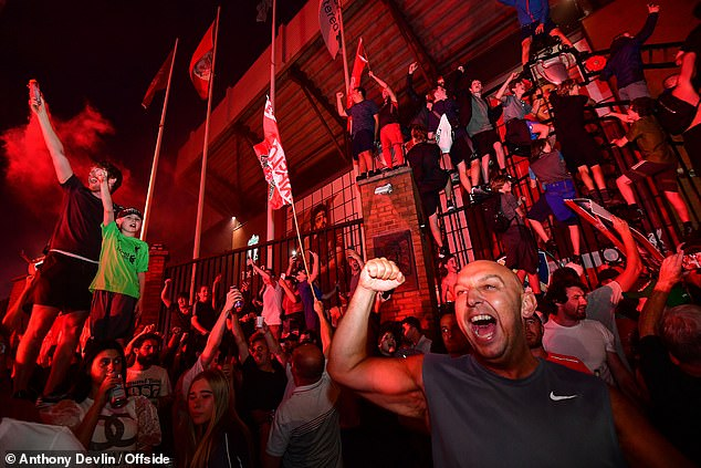 Liverpool fans go wild after Manchester City's defeat by Chelsea confirmed their title
