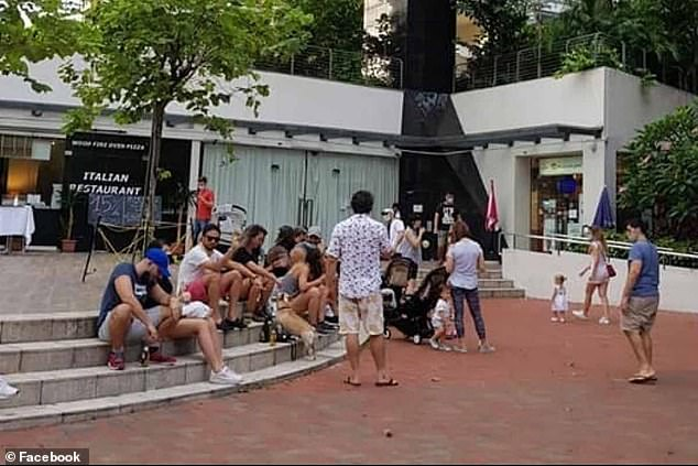 Four Britons were banned from working in Singapore and fined £ 5,000 each after this image of people drinking in public in violation of the lockout went viral. The four drank on this square the day this photo was taken, although it is not clear if they are shown here