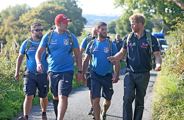 Prince Harry's association with the charity goes back several years (pictured, with six former military soldiers as they undertake The Walk of Britain covering over 1000 miles from John O'Groats to Buckingham Palace in 2015)