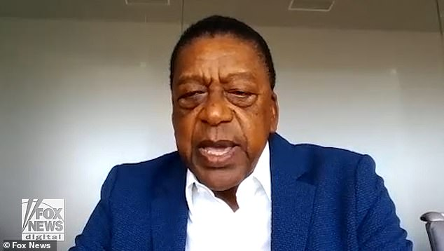 BET founder Robert Johnson has called for the US to pay $14 trillion in slavery reparations to bring 40 million African-Americans in line with the wealth of white Americans, as he says the nation 'has never come to grips with its original sin of slavery'