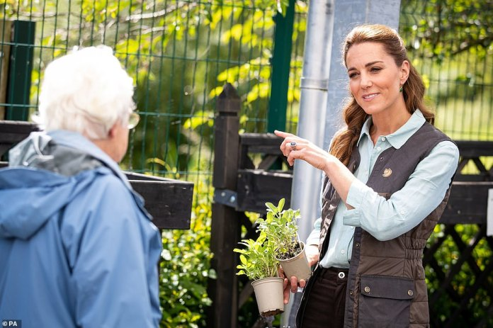 The Duchess of Cambridge speaks with a member of the public as she purchases plants and herbs in her local garden center