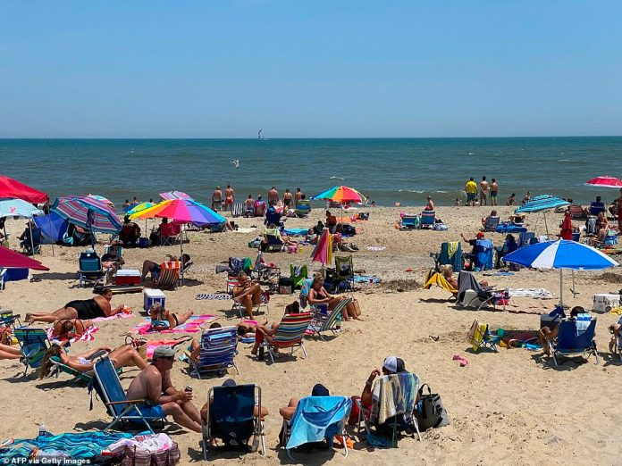 VIRGINIA: Residents bask in the sun and lie on the sand of Chincoteague beach on Saturday amid the coronavirus pandemic