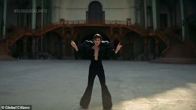 What outfit: she danced a storm in a plunging black jumpsuit that showed her extravagant swollen belly and shoulders
