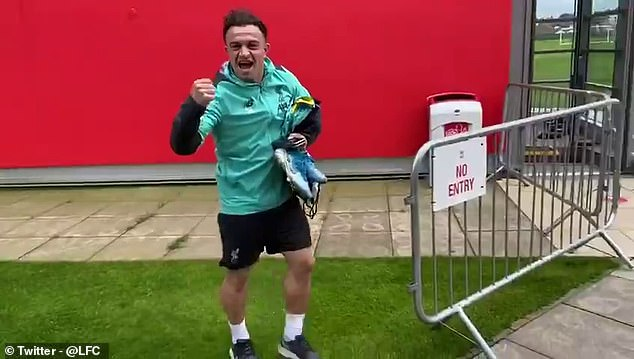 Shaqiripumped his fists upon his arrival at Liverpool's training ground following title triumph