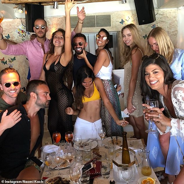 Mr Rubenstein (centre) parties with glamourous friends and plenty of high-grade booze