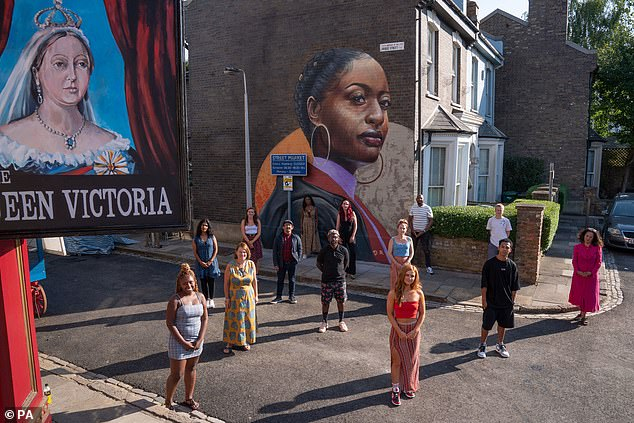 Real world: Jon Sen, executive producer of EastEnders, said: `` Dreph's mural is an exciting and timely addition to the show that reflects the events taking place in the real world ''