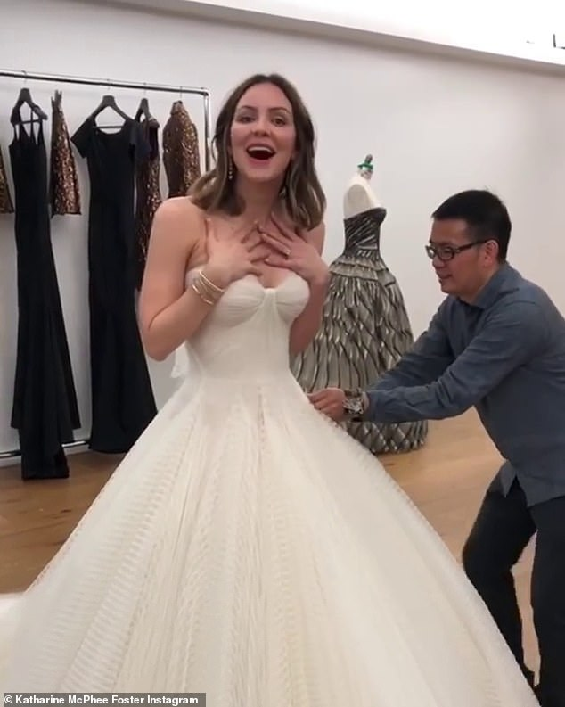 Say yes to the dress! She also shared behind-the-scenes footage of herself trying on her gorgeous wedding dress