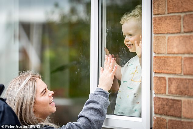 The mother-of-one was only able to visit her son through the safety of a window during her period of self-isolation to keep George safe
