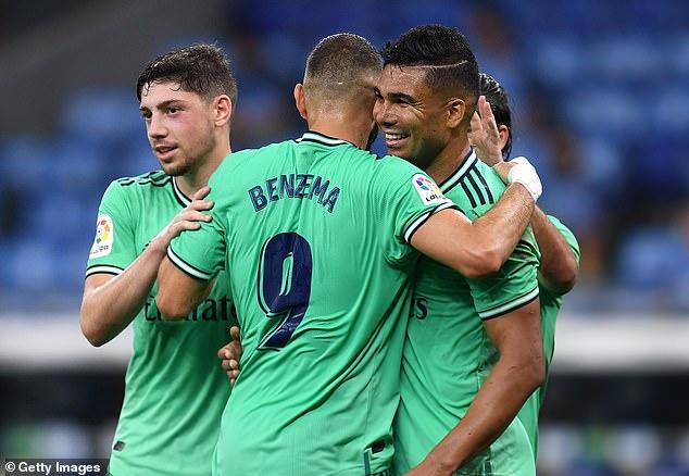 Casemiro celebrates after he scored following a wonderful assist by striker Karim Benzema