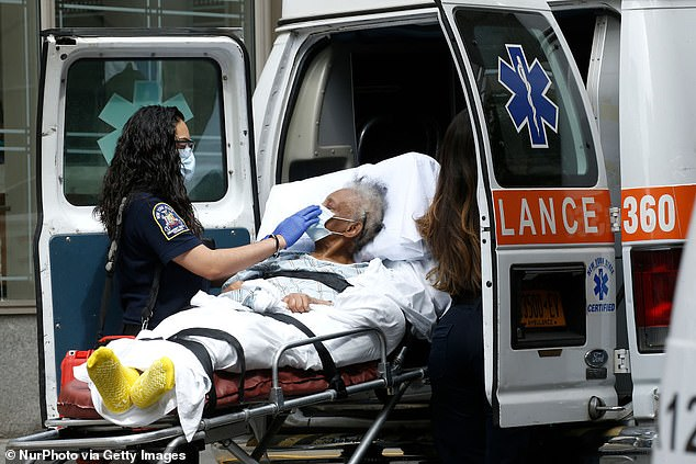 United States: EMT staff take a patient to an ambulance in front of Mt. Sinai Morningside Hospital May 18 in New York