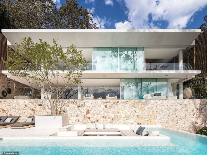 Going, going, gone! The waterfront home (pictured) was sold by listing agent Ken Jacobs, who on Monday flagged the property online as 'sold'. According to Domain, the buyer was willing to meet the couple's $20million asking price