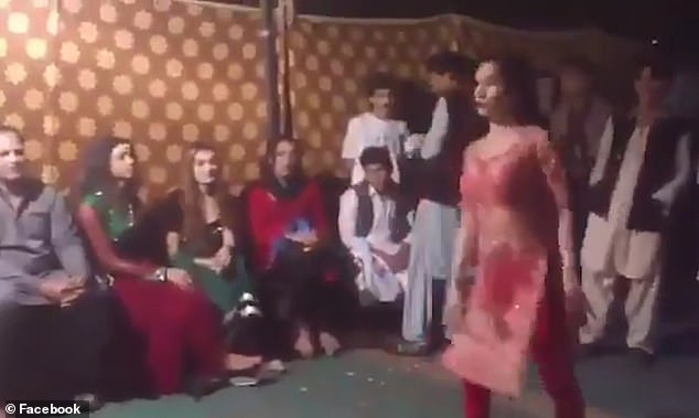 A woman was violently kicked by a man while dancing at an event in Pakista