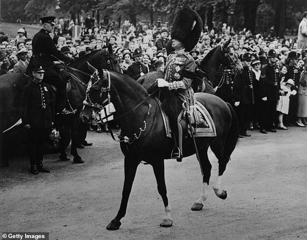 King Edward VIII in military uniform riding from Hyde Park in London having presented the colours to the guards in July 1936