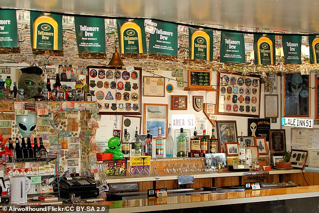 The bar at the Little A'le'Inn, where dollar bills are pinned to the ceiling. The picture was snapped by Flickr user Airwolfhound and appears here courtesy of Creative Commons licensing