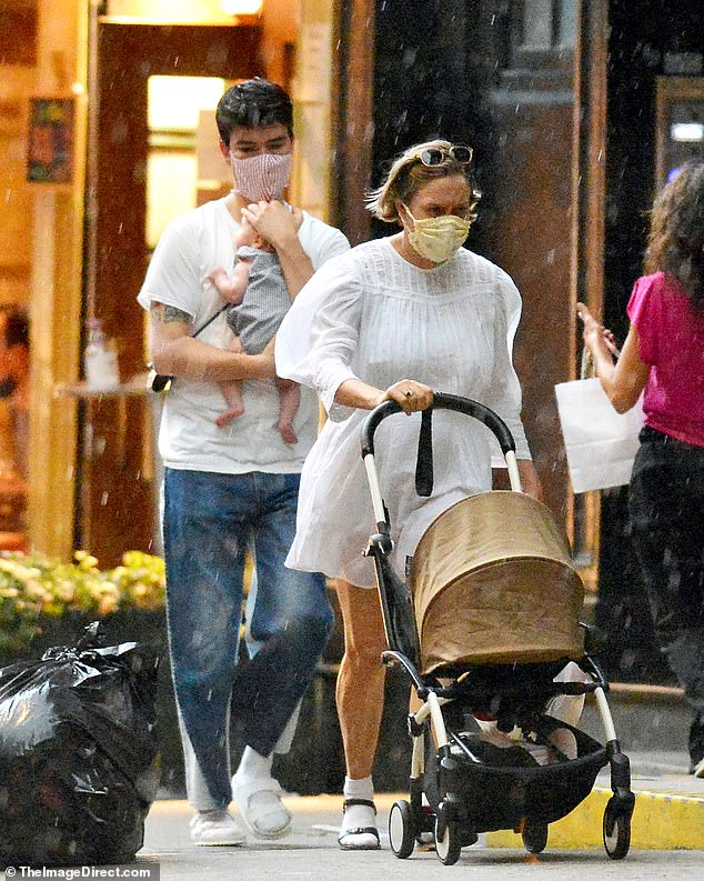 Baby love: Queen & Slim actress Chloë Sevigny and her rumored fiancé Sini¿a Mackovic got caught in the rain while strolling with their eight-week-old son Vanja in Manhattan on Sunday