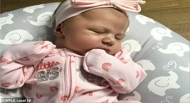 The newborn girl, pictured, was healthy after one of the fastest deliveries the center has seen