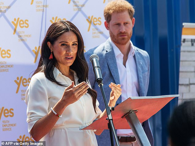 Meghan Markle (pictured with her husband Prince Harry in 2019) has 'very high standards' and her Hollywood gung-ho attitude put her at odds with Royal aides - as they felt she 'rushed into situations without proper research', according to an explosive new book