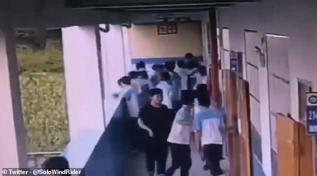 Students relax during a break at a middle school in southern China before the incident occurs