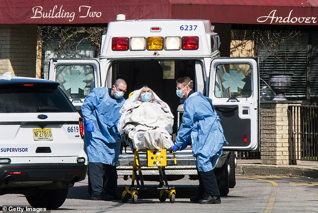 Approximately 100,000 people died from Alzheimer's disease and dementia between February 2020 and May 2020, about 15,000 more than would have normally occurred. Pictured: Medical workers load a patient from Andover Subacute and Rehabilitation Center into an ambulance in Andover, New Jersey, April 16