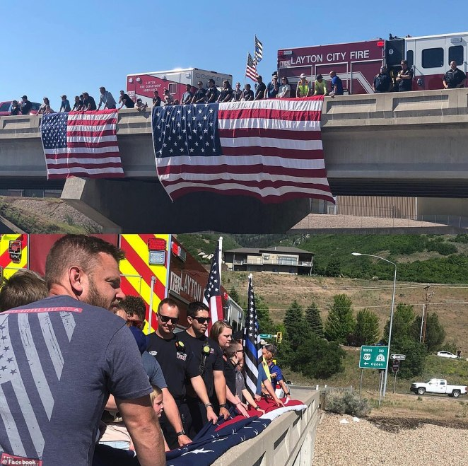 Most attendees (pictured) held American flags as they welcomed Allen home. Service members saluted fallen pilot as the white hearse carrying his body passed by