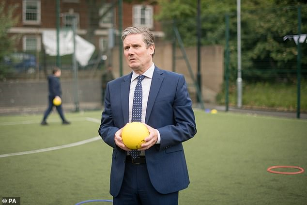 Sir Keir Starmer, pictured at a north London school on Monday, was branded 'a cop in an expensive suit' by activists