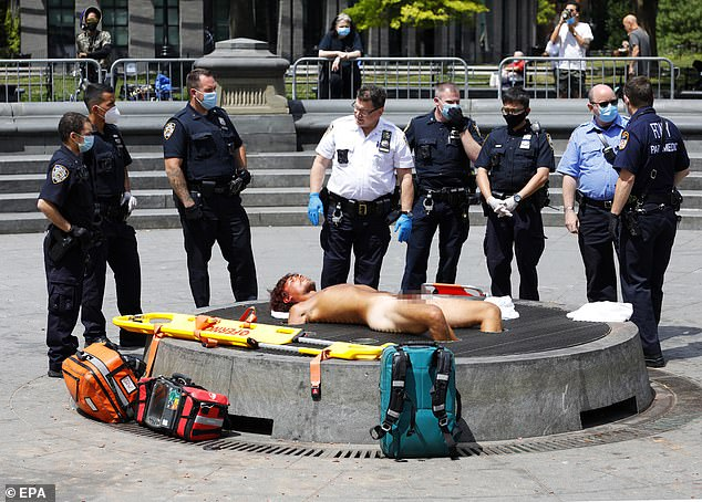 Deja vu: For the third time in as many days, nude squatter Matthew Mishefski, 25, was found sleeping in the middle of the Washington Square Park fountain of Monday