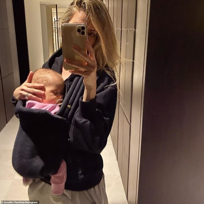 So precious: The 2004 Miss Universe also posted this heart-melting picture to Instagram of herself cradling eight-month-old Frankie in a baby sling, while also showing off her dazzling diamond engagement ring