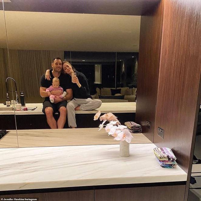 'These two!' Jennifer Hawkins enjoyed a cosy night in with her husband, Jake Wall, and their baby daughter, Frankie Violet, on Monday, just hours after it was reported they had sold their Northern Beaches mansion for $20million