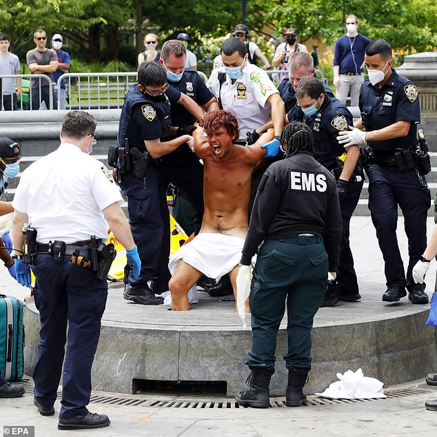 Violent crime - including shootings and murders - are on the rise in New York, with lower level crimes also going repeatedly unchecked (pictured:squatter Matthew Mishefski is removed from Washington Square Park fountain after weeks)