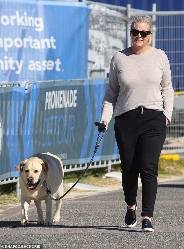 Newly-engaged glow! On Tuesday, Samantha Armytage, 43, looked happy and relaxed as she enjoyed a morning stroll in Bondi with her dog, Banjo