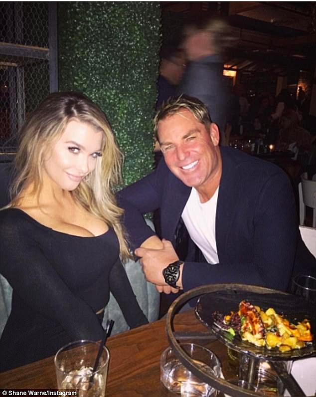 Former flames: Emily first shot to fame after she was romantically linked with Australian cricket legend Shane Warne in 2017 (Pictured together)