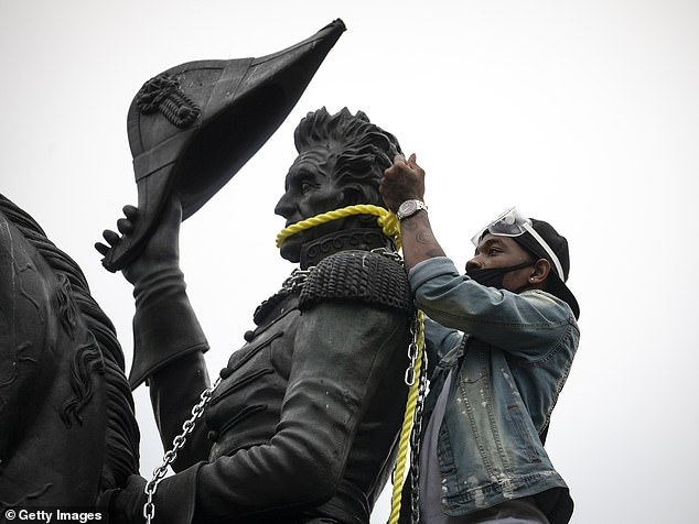 Protesters attempted to pull down the statue of Andrew Jackson in Lafayette Square near the White House last week in Washington, DC. Protests continue around the country over the deaths of African Americans while in police custody