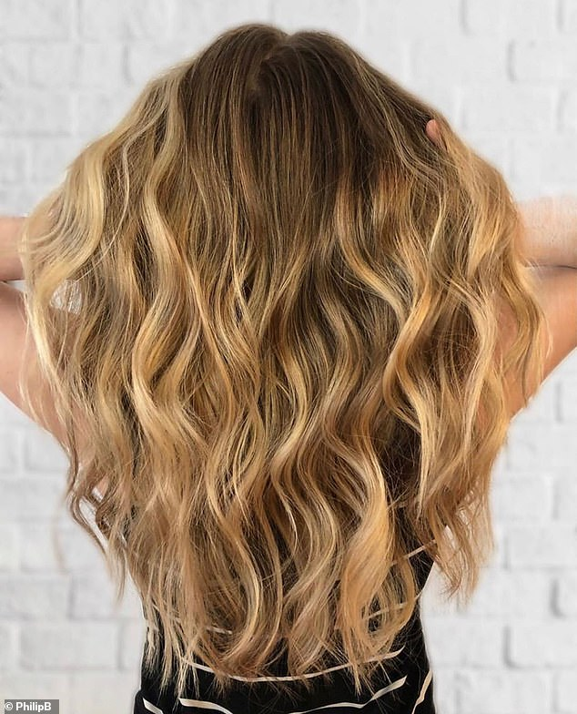 For glossy hair without frizz or grease (pictured), celebrity hair stylist Philip B recommends applying oil through the mid-lengths and brushing regularly with a natural and nylon brush