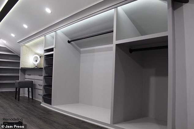The room features an abundance of rails and shelving to hang clothes and display accessories