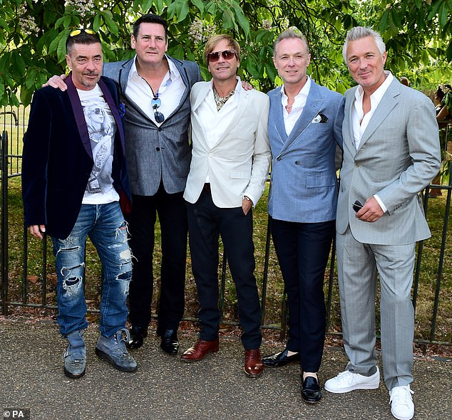 Making a comeback? Spandau Ballet's Gary Kemp (second right) says he wants the band to reform, but the ball is in singer Tony Hadley's (second left) court. Pictured in 2015