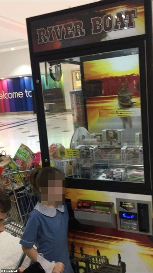 The father of a young girl whose arm became stuck in a vending machine for nearly an hour has told of taking matters into his own hands to free the girl