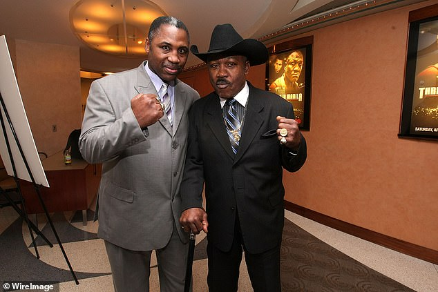 Marvis Frazier (left) with his famous boxing father, 'Smokin'' Joe back in 2009