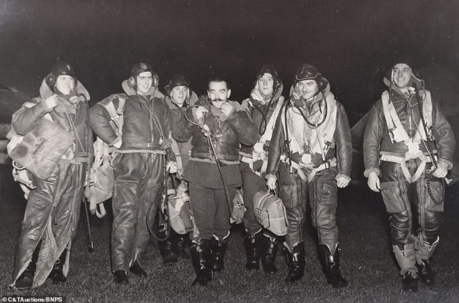 A group of brave pilots wear their flight gear as they prepare to take to the skies during the Battle Of Britain.  The air battle , which took place from July 10 to October 21, 1940, saw Britain's Royal Air Force (RAF) defend the country against Nazi Germany's destructive air raids