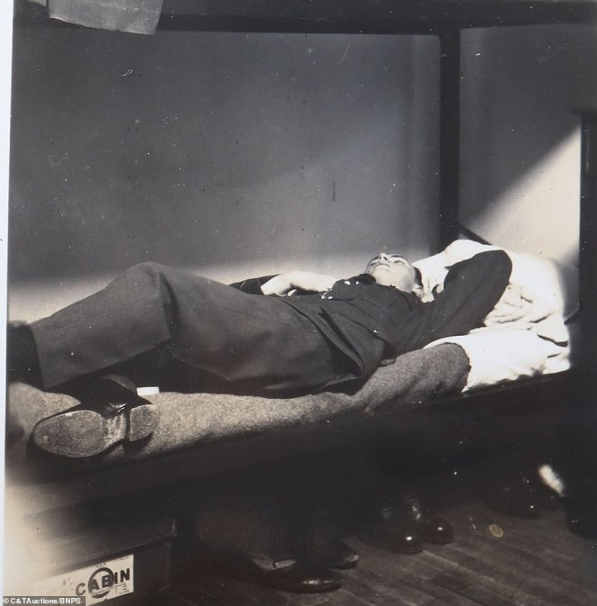 A crew member lies on his bunk bed and takes a well-earned break in his dormitory as he and a legion of pilots fight against the German planes in 1940