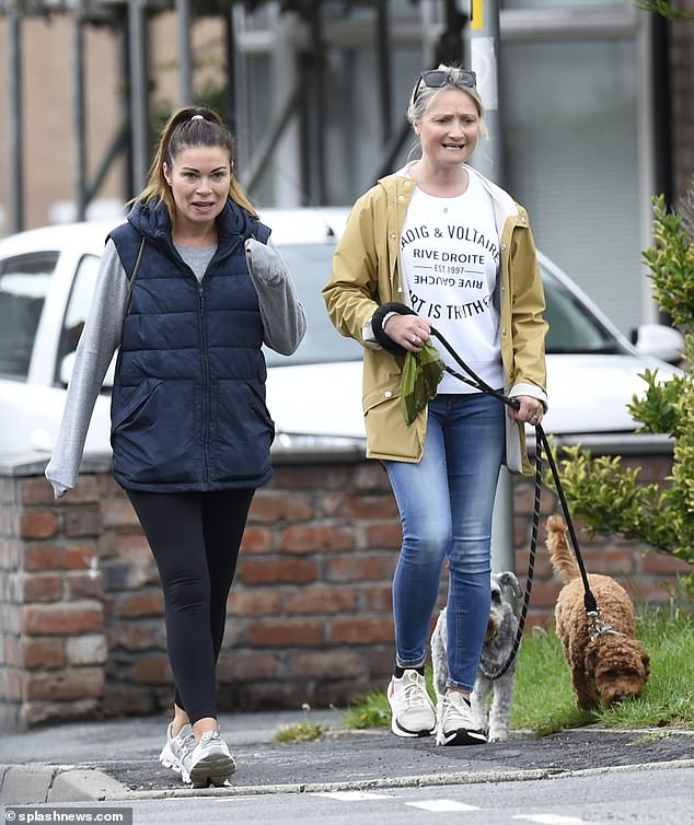 Out and about: The actress, 47, who plays Carla Connor in the ITV soap, donned comfy sportswear including a padded navy gilet as she took a stroll around her local area