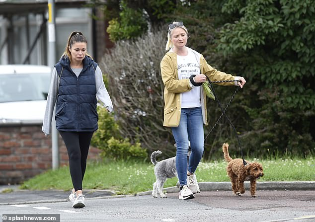 Downtime: Actress Alison joined a pal as they walked her dogs in their local Cheshire area