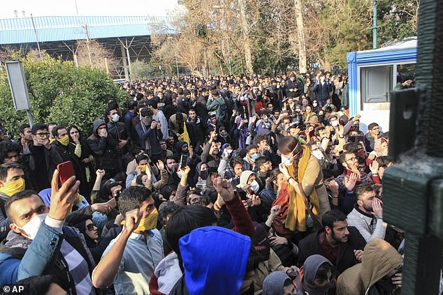 Zam ran a channel on the messaging app Telegram that spread messages about upcoming protests in 2017 and shared videos from the demonstration. Above,, university students attend a protest inside Tehran University while anti-riot Iranian police prevent them to join other protestors, in Tehran, December 2017