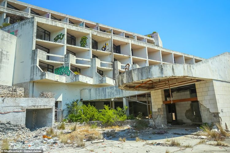 The exterior of the Hotel Goričina, which has crumbling walls and is daubed with graffiti