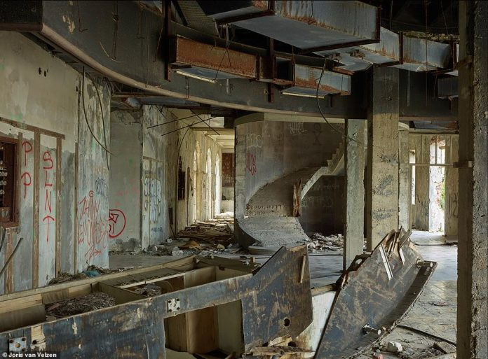 During the war, each hotel floor was looted and gutted with phosphorus bombs. Pictured is the interior of the Grand Hotel