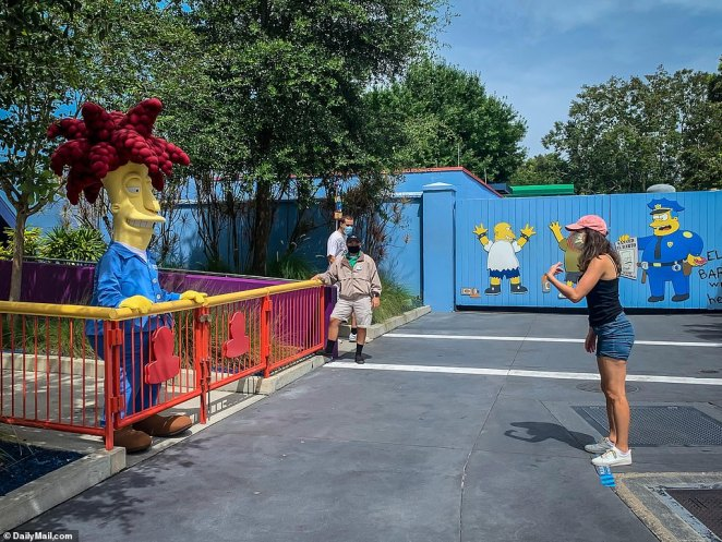 Visitors wanting to take pictures with characters must stand 12 feet away, including outside The Simpsons Ride where Sideshow Bob is seen