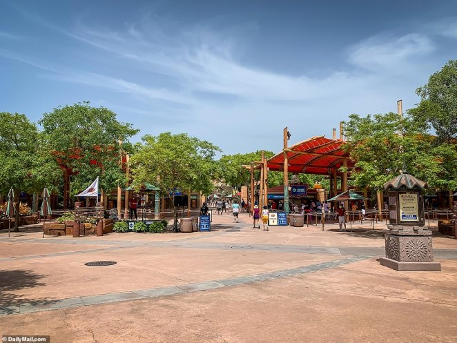 Patrons enter Universal's Islands of Adventure in Orlando, Florida, which opened at reduced capacity