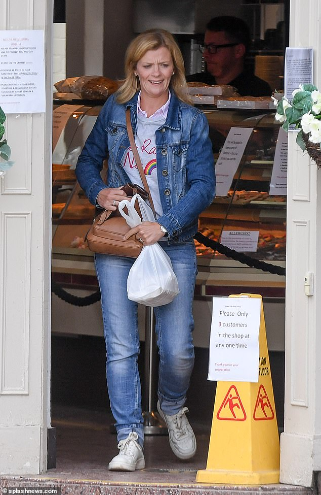 Out and about: Jane Danson, 41, opted for a laid back look as she grabbed a bite to eat from a bakery in Wilmslow, Cheshire on Tuesday