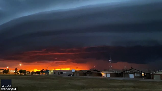 A video capturing the weather event was taken in Clovis on June 23 and shows a stunning sunset in the distance with lightning striking from the massive disk-shaped cloud