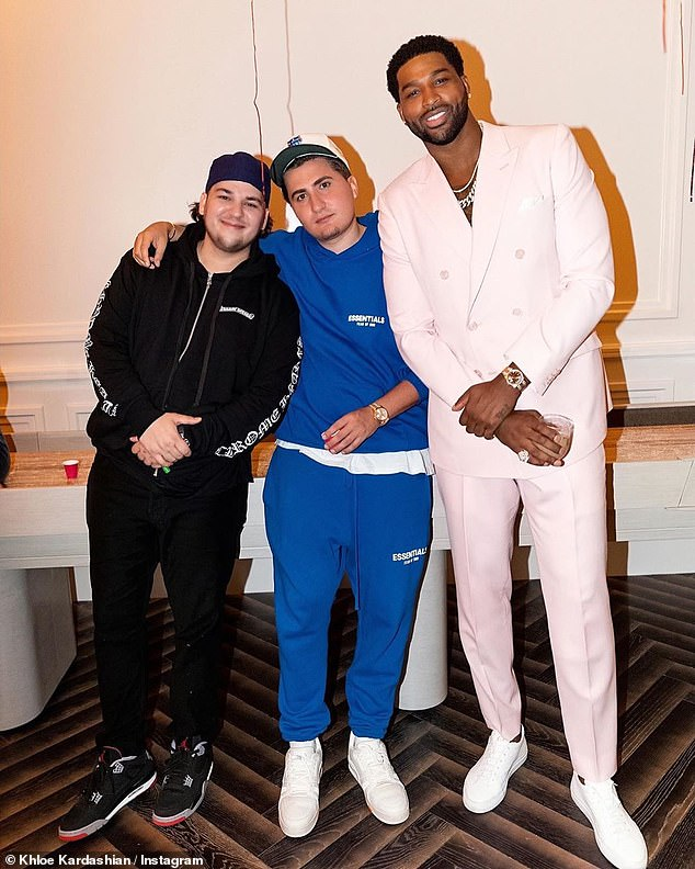 Squad goals: Tristan also seemed to have a blast at the gathering as he hung out with Khloe's brother Rob Kardashian (left) and their pal Savas (center)