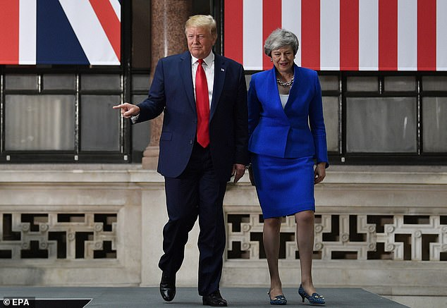 Donald Trump told former UK prime minister Theresa May (pictured together on a presidential visit to London in 2019) that she was weak and lacked courage, it is claimed